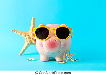 Happy piggy bank with sunglasses and starfishes on color background, space for text. Finance, saving money