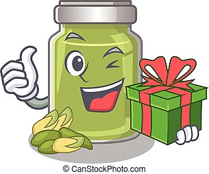 Happy pistachio butter character having a gift box