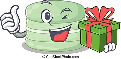 Happy pistachio macaron character having a gift box