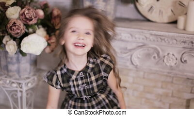 playful girl laughing and jumping and making faces