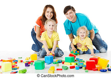 Happy playing toy blocks over white