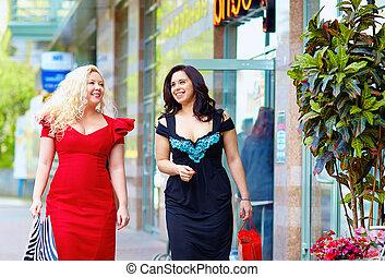 happy plus size women shopping