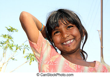 A portrait of a happy poor girl from India.