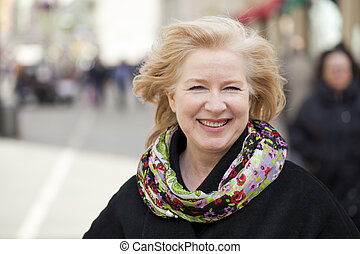 Happy portrait of an elderly blonde woman
