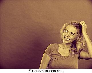 Happy positive blonde woman gesturing hands