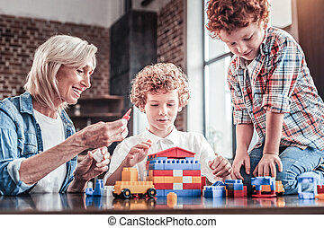 Happy positive family playing with the constructor set
