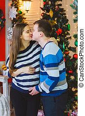 Happy pregnant couple hugging
