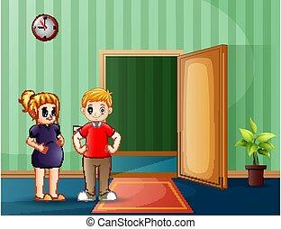 Happy pregnant couple standing in front of open door
