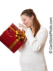 Happy pregnant girl with gift.