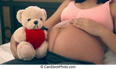 Happy pregnant woman and expecting baby at home. - Pregnant ...