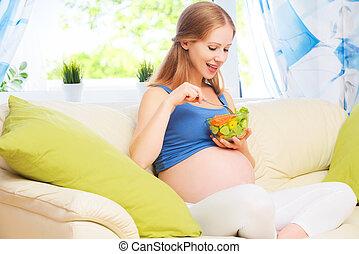 happy pregnant woman eats healthy food vegetable salad