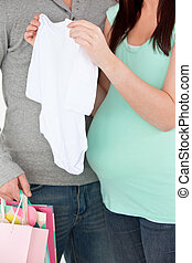 Pregnant woman in a shop