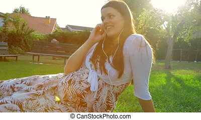 Happy pregnant woman on the phone l