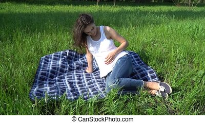 Happy pregnant woman relaxing and enjoying life in nature.