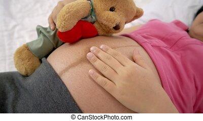 Happy pregnant woman sleeping on bed in bedroom. - Happy ...
