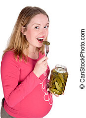 tasting pickle - Happy pregnant woman tasting pickle ...