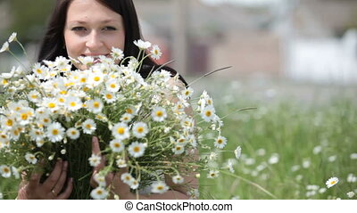 Happy pregnant woman with bouquet