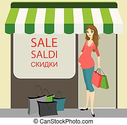 Happy pregnant woman with shopping bags near store