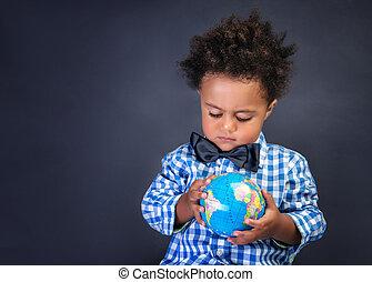 Happy preschooler discovering world, african boy looking on...