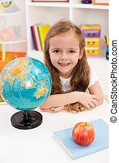 Happy preschooler eager to go to school
