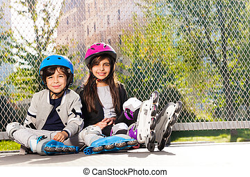 Happy preteen boy and girl in roller skates