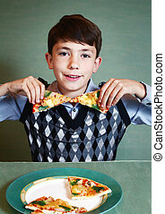 boy with pizza plate on blue background