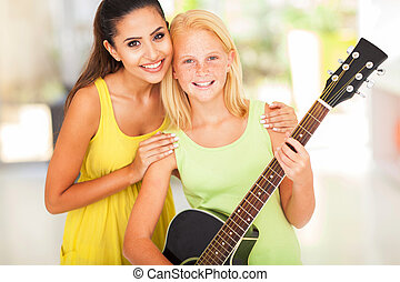 preteen girl with her music teacher - happy preteen girl ...