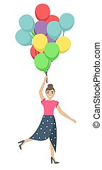 Happy pretty girl with balloons in her hands. Flying on a bunch of balloons.