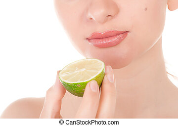 Happy pretty model posing with half of lime