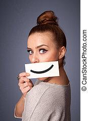 Happy pretty woman holding card