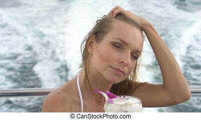 Happy pretty woman on yacht cruise