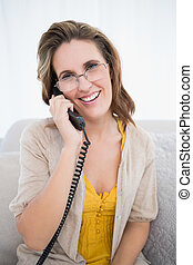 Happy pretty woman talking on the telephone
