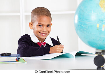 happy primary school boy in classroom