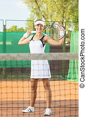 Happy Professional Female Tennis Player At Court