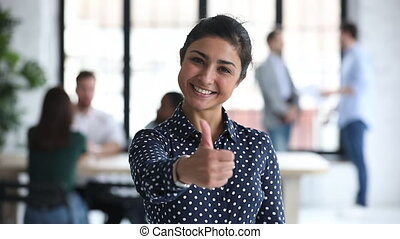 Happy proud indian businesswoman professional showing thumbs...