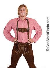 Happy proud man with oktoberfest leather trousers (lederhose)