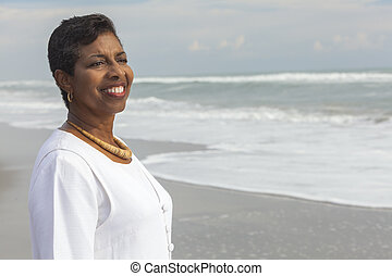 Happy Proud Senior African American Woman on Beach