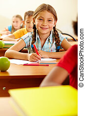 Happy pupil - Portrait of lovely girl drawing in copybook at...