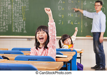 happy pupils raising hands during the lesson