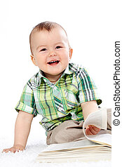 Happy reader - Portrait of happy boy with open book over...