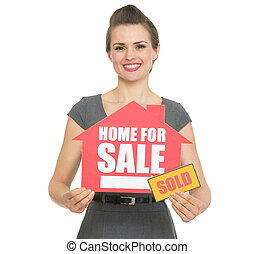 Happy realtor showing home for sale sold sign