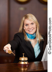Happy Receptionist Giving Room Keys To Customer - Happy...