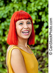 Happy red hair woman in a park