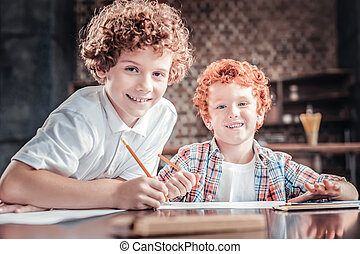 Happy red haired boys looking at you