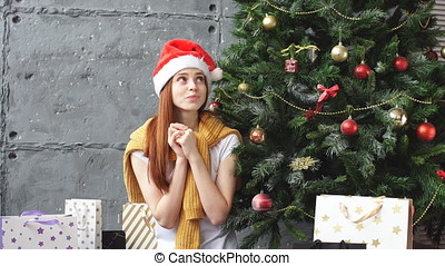 Happy redhead girl makes a wish for Christmas.