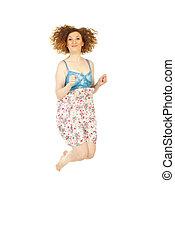 Happy redhead woman jumping