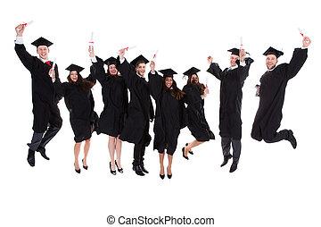 Happy rejoicing group of multiethnic graduates
