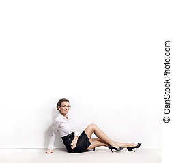 Happy relaxed businesswoman under empty white board , lots of copyspace