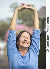 Happy relaxed mature woman outdoor - Portrait attractive ...