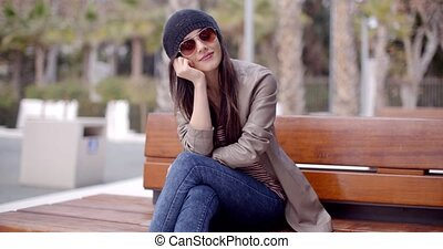 Happy relaxed trendy woman sitting daydreaming - Happy...